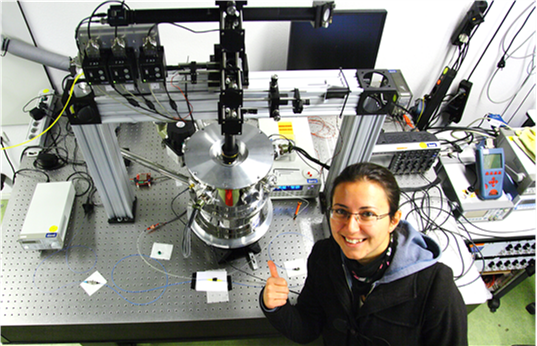 This is Döndü's experimental setup from her PhD. The shiny metal in the middle is the cryostat in which she did experiments using superconducting detectors. Inside the cryostat temperatures drop as low as -271 ◦C.