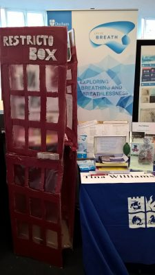 restricto-box next to the suffering in silence display table, which features a banner reading 'Exploring breathing and breathlessness'