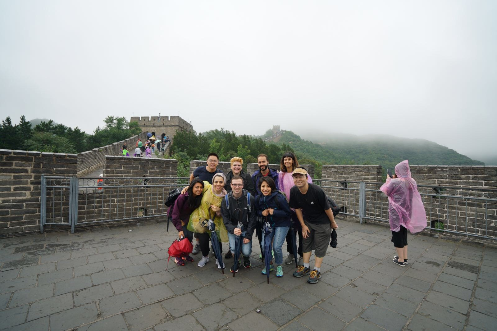 A group of postgraduate researchers on the Great Wall of China.
