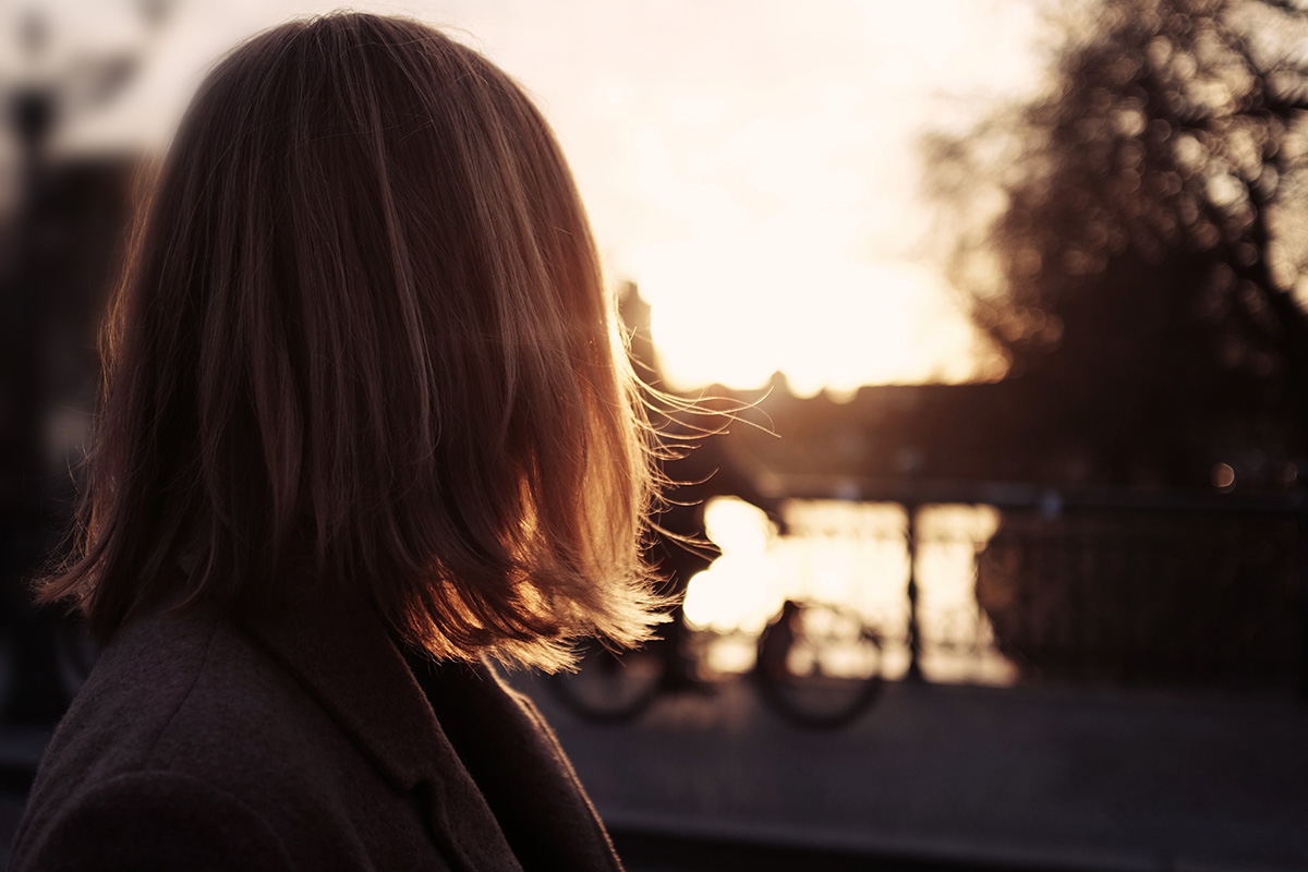 A woman looking at the sunset
