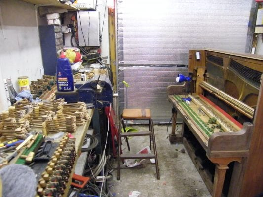 A pianola in the middle of restoration