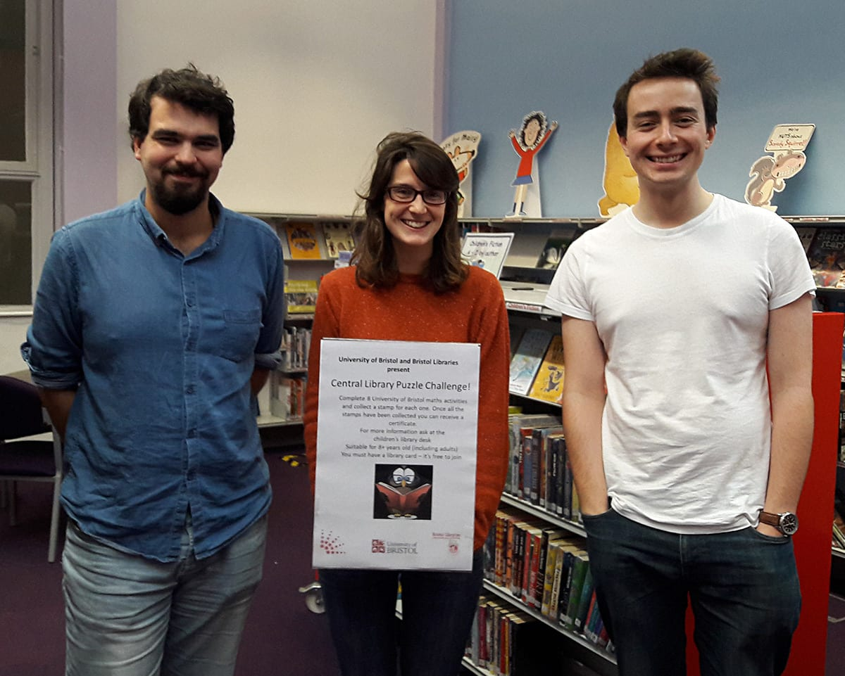 Sophie Stevens (centre) with Florian Bouyer (left) and Joe Allen (right) at the launch of the Central Library Puzzle Challenge.