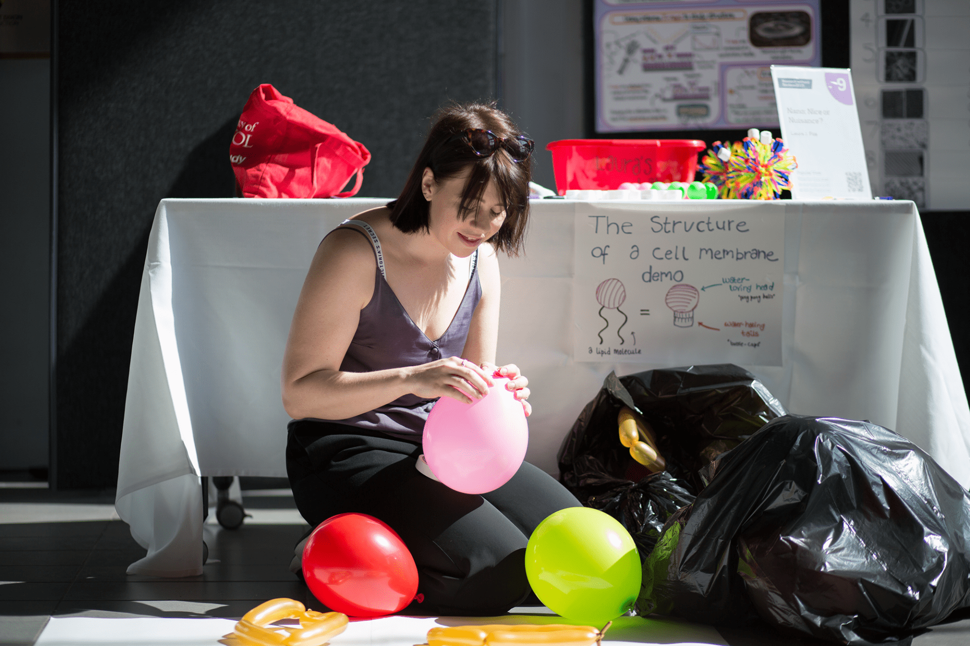 Laura Fox tying up an inflated balloon
