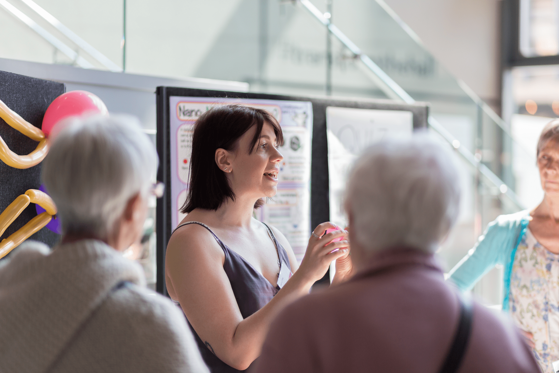 Laura Fox talking to a group at the Research without Borders 2019 exhibition