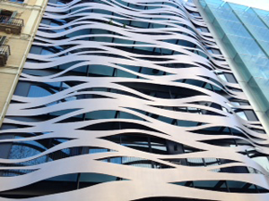 Abstract wave carving on building