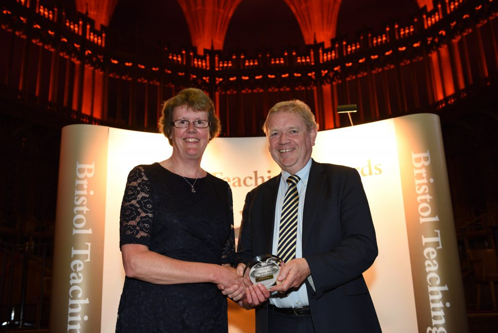 Dr Lesley Nolan receiving her award from Professor Jonathan Sandy
