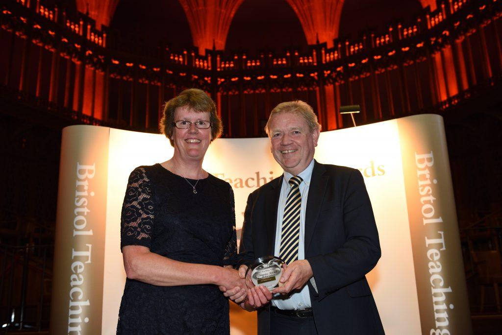 Dr Lesley Nolan receiving her award from Professor Jonathan Sandy
