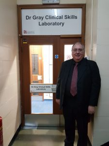 Dr Gray outside the Dr Gray Clinical Skills Laboratory.