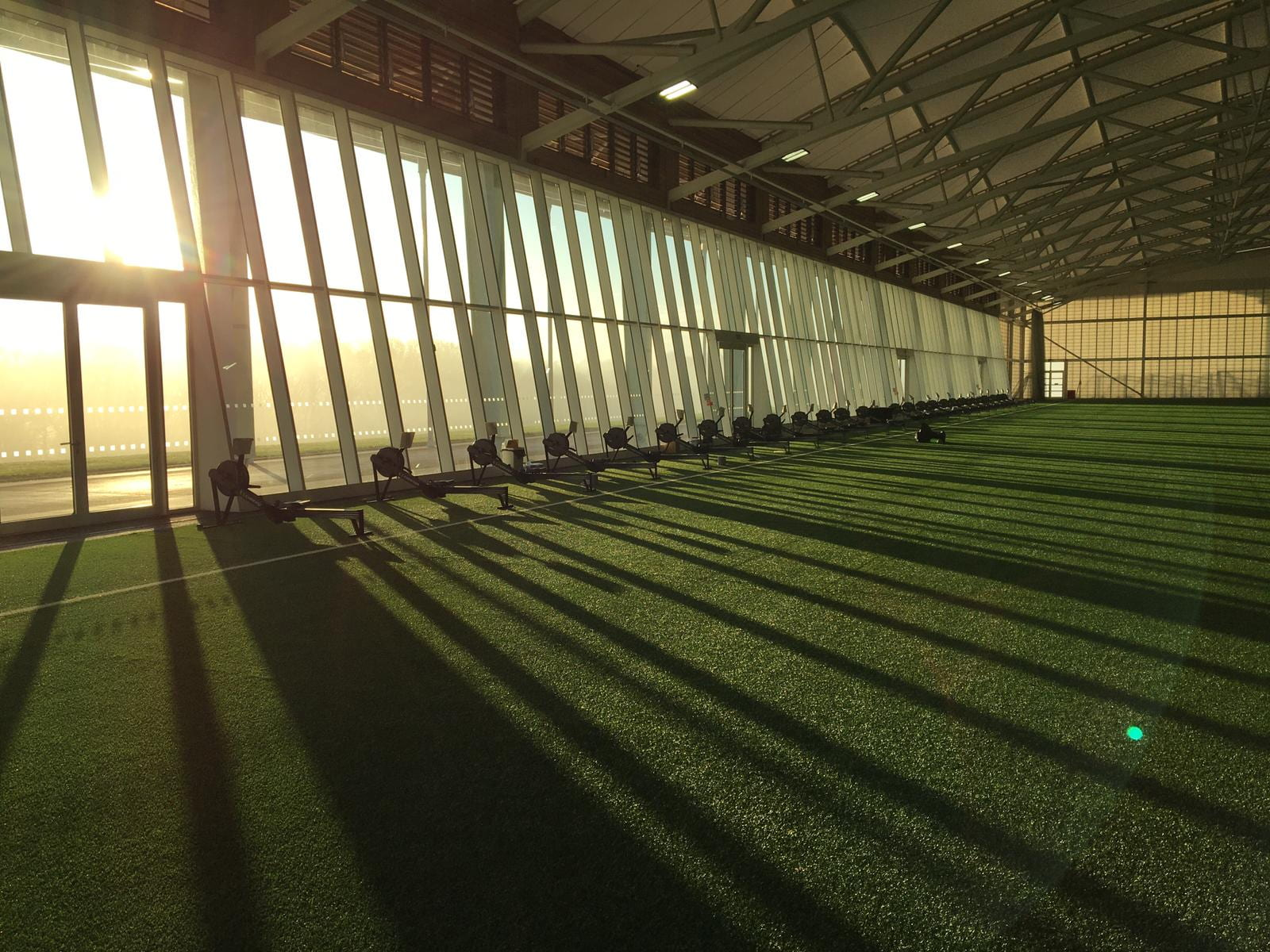 A room with static rowing machines in