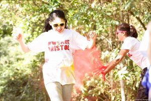 Student having paint thrown on them during Colour Run event