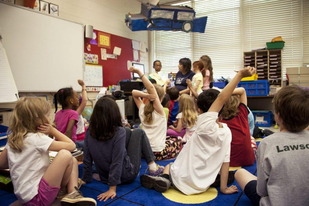 young children speaking in classroom