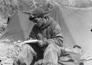 Trooper of King's Royal Hussars, Writing Home c. 1950. Copyright: Imperial War Museum.