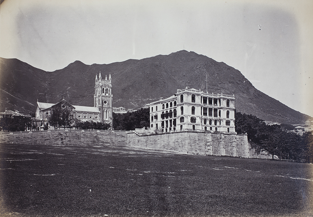Black and white photograph depicts St John's Cathedral and the Augustine Heard & Company house.