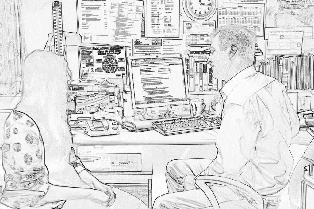 An image of a patient sitting with a GP at a GP consultation in a GP office. The image has been put through a filter to obscure identity.