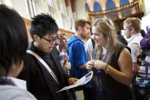 Students and employers at a careers fair in the Great Hall of the Wills Building