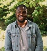 A photo of Obafemi, smiling