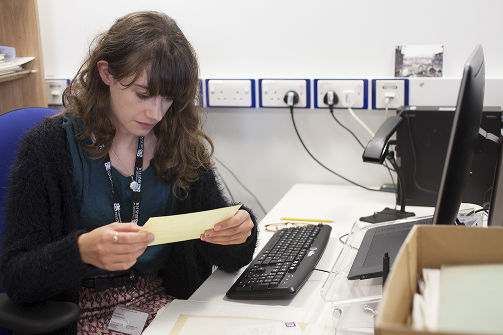 Evie Porat cataloguing part of the Penguin Archive, July 2017. Photograph by Jamie Carstairs.