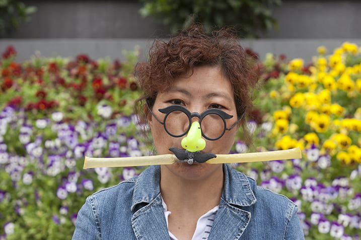 A woman selling a children's toy, Nanjing Road, Shanghai, May 2011. Photograph by Jamie Carstairs.
