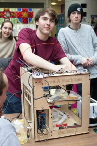 students demonstrate a prototype 3d printer that uses butter