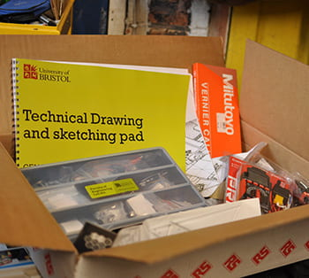 Open box showing the contents of the engineering kit