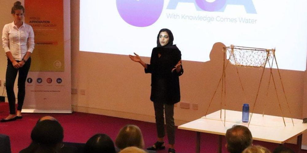 Ilham Said addresses a conference