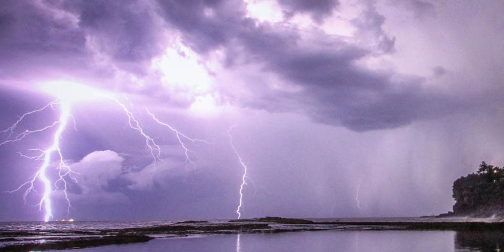 Lightening storm with beach in foreground, photographer: Jeremy Bishop