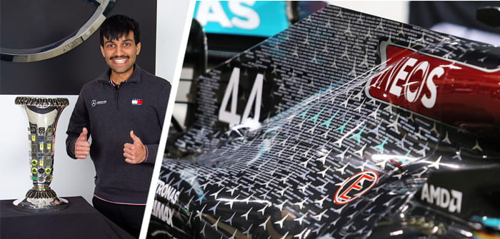 Student Rohit with Formula E trophy and car livery