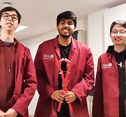 Engineering students holding the LEGO grabber
