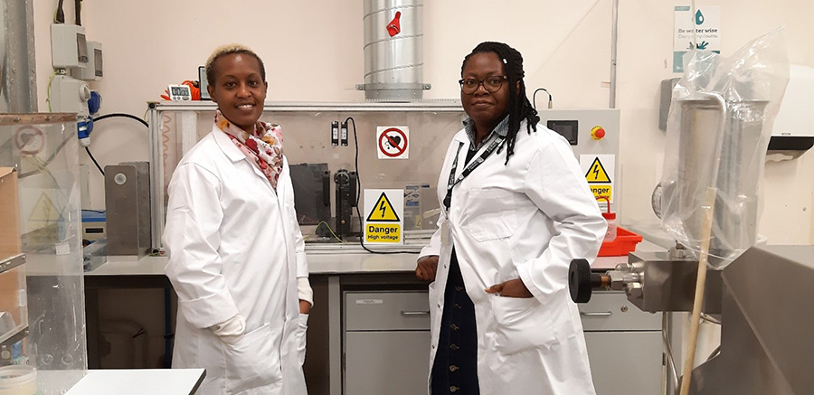 Dr Anita Etale (left) and Dr Amaka Onyianta (right) with the electrospinning equipment in Queens building.
