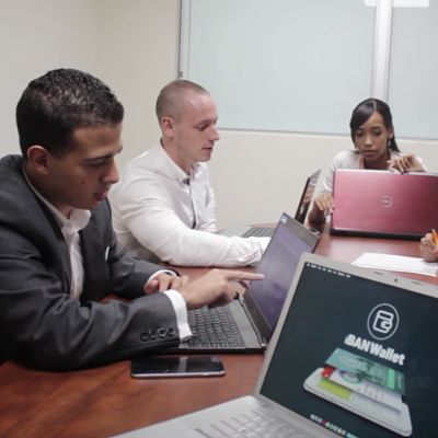 Marc-Anthony Hurr working with colleagues at IBAN