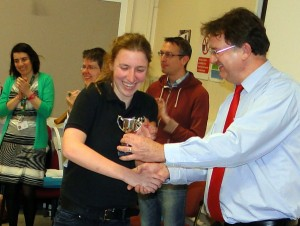 Jen Atherton receives the  Challenge Cup 2015  from President Garry Atterton on behalf of a Backwell School team.