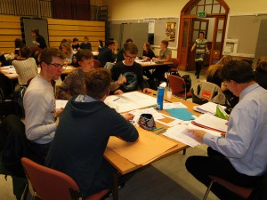Teams from Backwell, Gordano, Redland High, St. Mary Redcliffe and Temple rapidly prepare posters