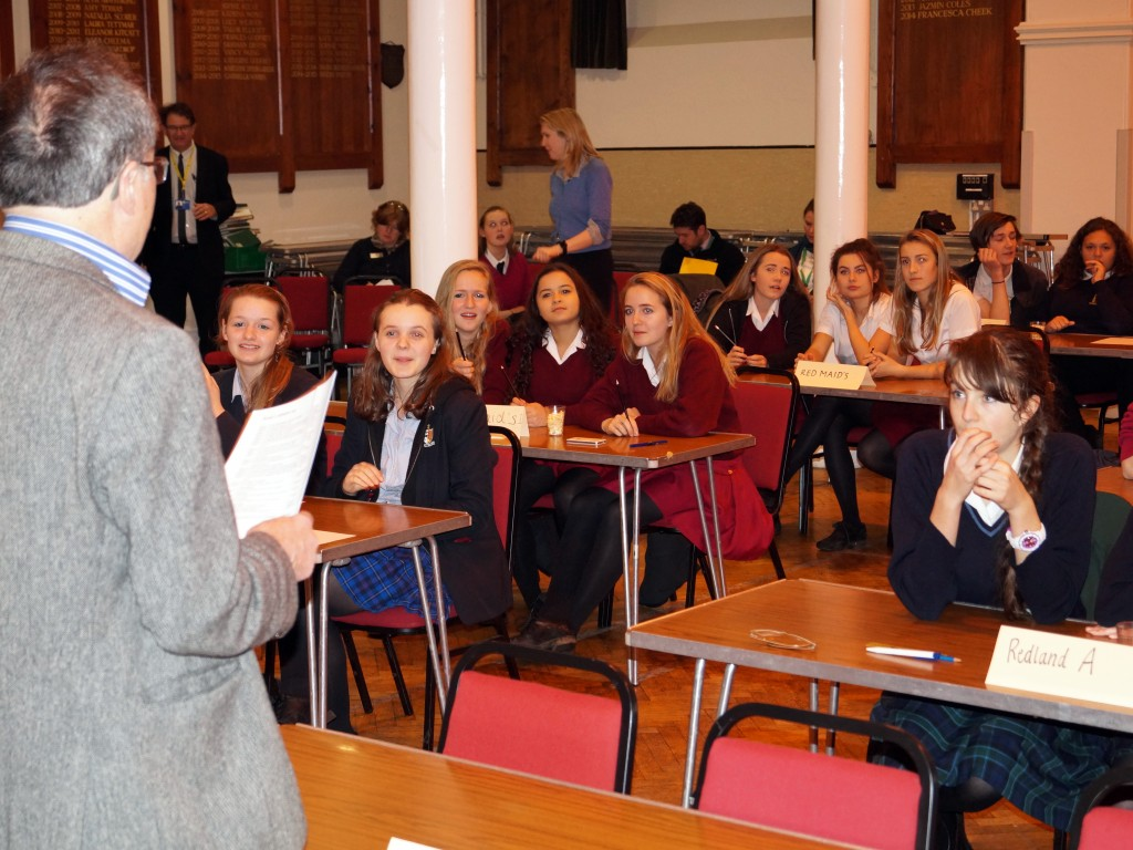The teams await the first questions from the quizmaster, Dr. Tony Hoare