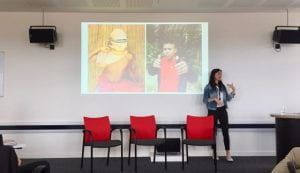 Image of two Matses children on the screen, and Camilla Morelli speaking