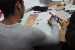 A young man draws a picture