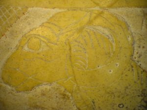 Faint carving of ram's head on shell