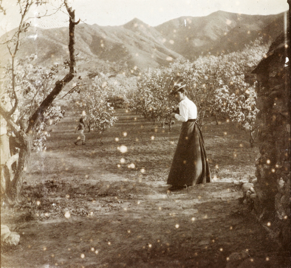 Muriel Carrall taking a picture at the 'Blossoms'