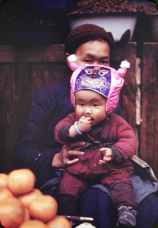 Boy with silk animal face hat, Kunming, 1945