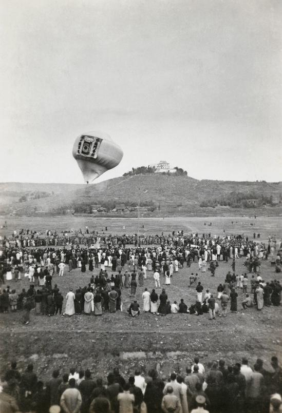 Sending up a balloon to advertise 'Hatamen' cigarettes, c.1925