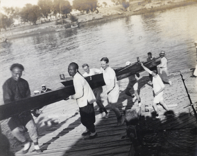 Carrying the rowing boat away from the river