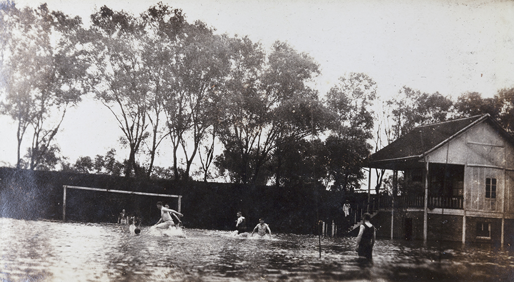 Playing football on a flooded pitch, unidentified location, 1930s, Masson collection, Ma01-173.