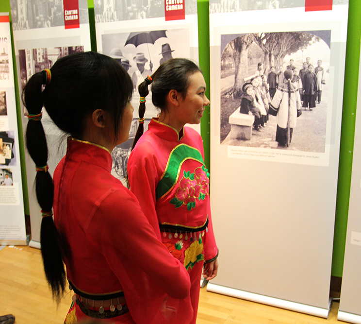 Dancers looking at Canton Camera, during Chinese New Year events, Bristol Museum and Art Gallery, 2013.  Photograph by Jamie Carstairs.