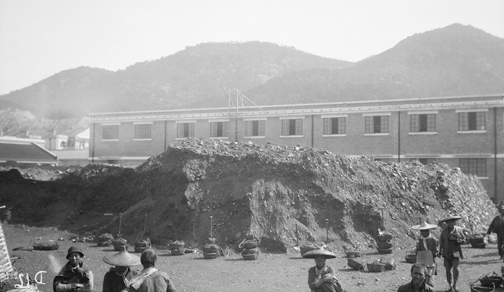 Coal heap, North Point Store, Hong Kong, 1919-1920.  Photograph by G. Warren Swire.  HPC ref: Sw04-015.  © 2007 John Swire & Sons Ltd.