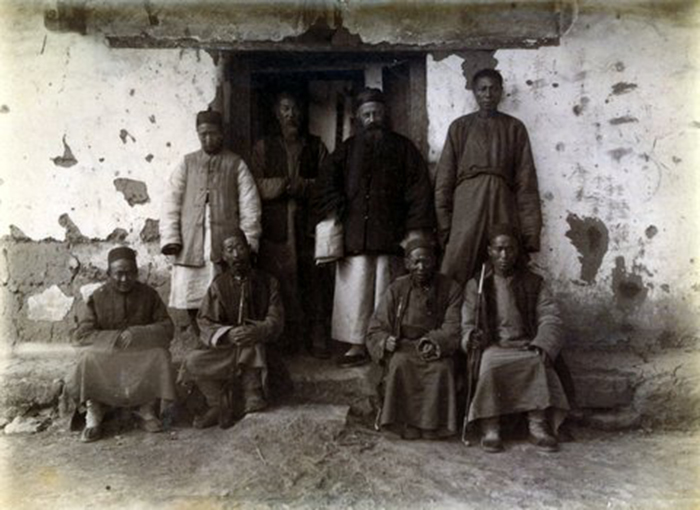 3. The Mission Station at Szu ku-shan: Father Braun and some of his flock, 1890. Photograph by Guy Hillier (Author's collection).