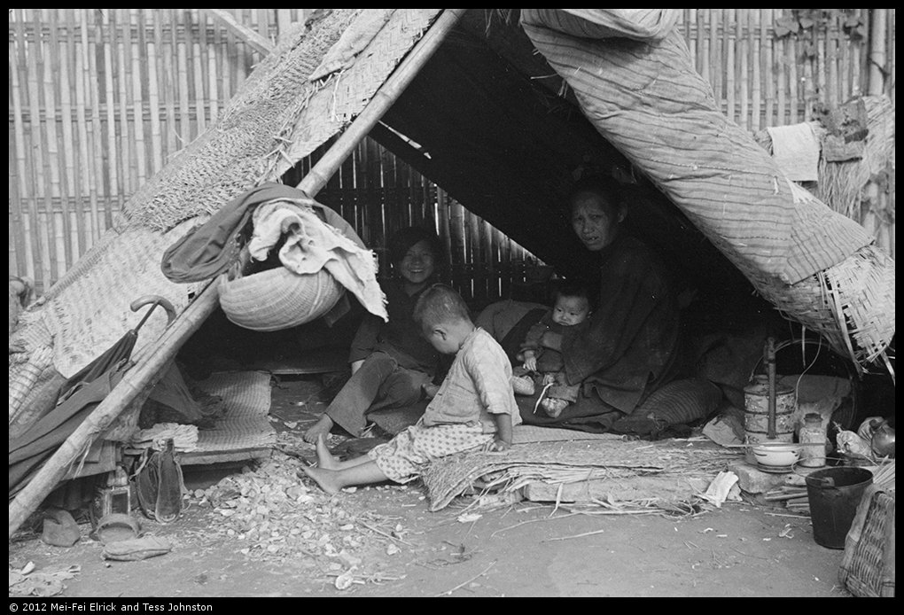 Woman and children in temporary shelter, Shanghai, Rosholt Collection, Ro-n0384.