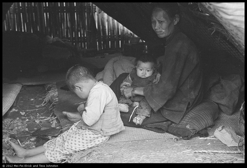 Women and children in temporary shelter, Shanghai, Rosholt Collection, Ro-n0385.