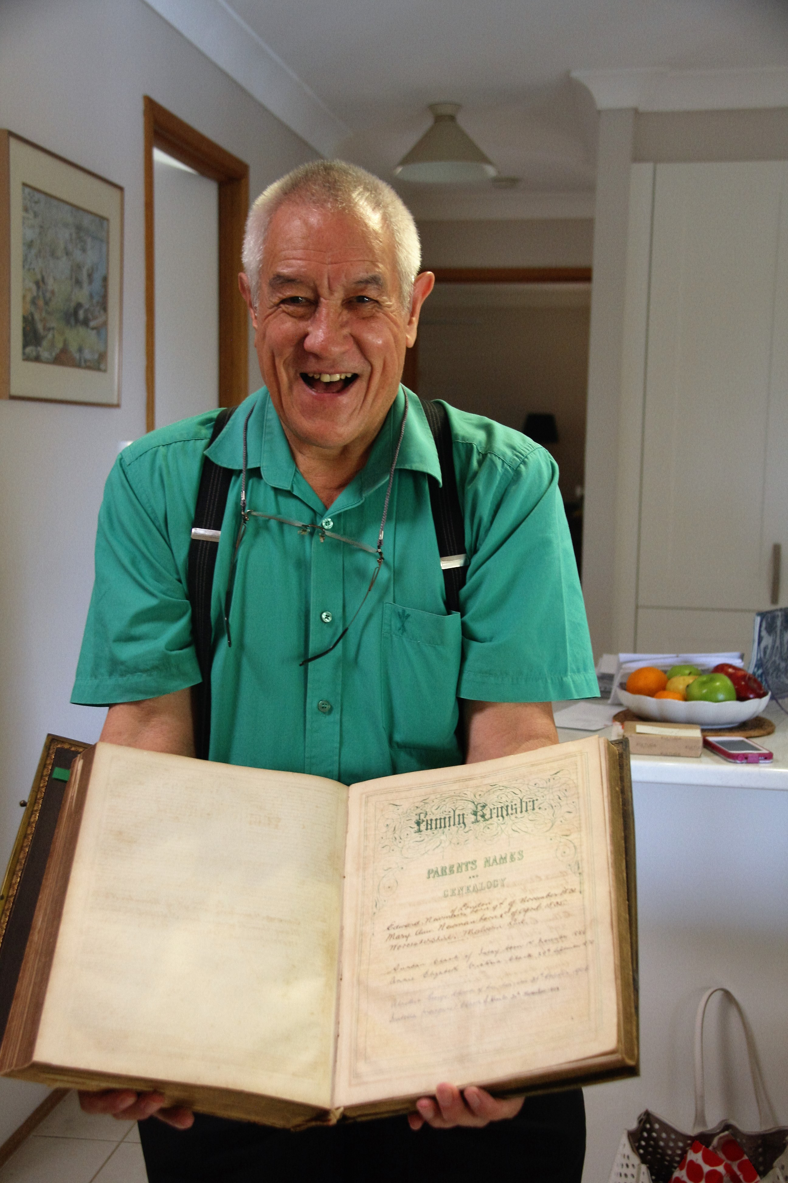 Holding the Newman Family Bible, with birth details of my great-grandparents Edward and Mary Ann Newman.