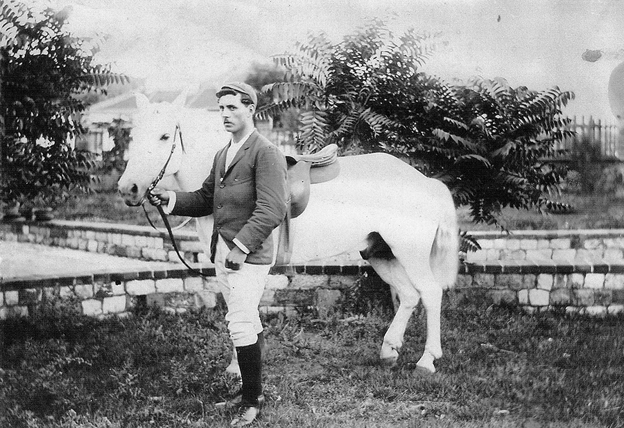 Frank Newman with a pony, Chefoo. Image courtesy of Duncan Clark.