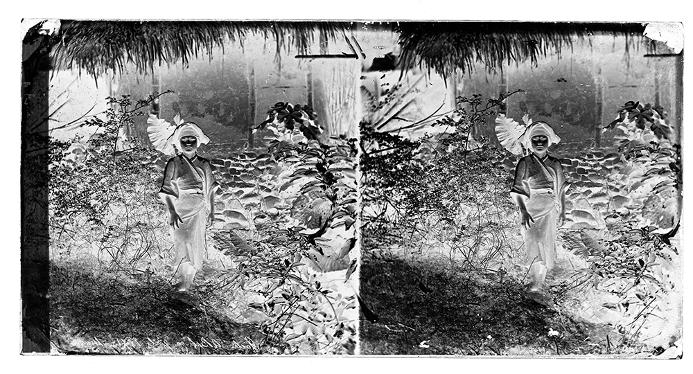 A scan of Thomson's stereoscopic negative numbered 770. 'Gochi, a Baksa girl 1871'. Credit: Wellcome Collection. CC BY.