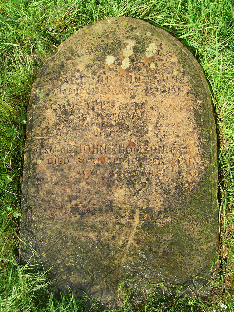 The fallen over grave stone of John Thomson, who is buried alongside his wife and his son Arthur, in Streatham Cemetery, Tooting, London. Photograph by Terry Bennett.